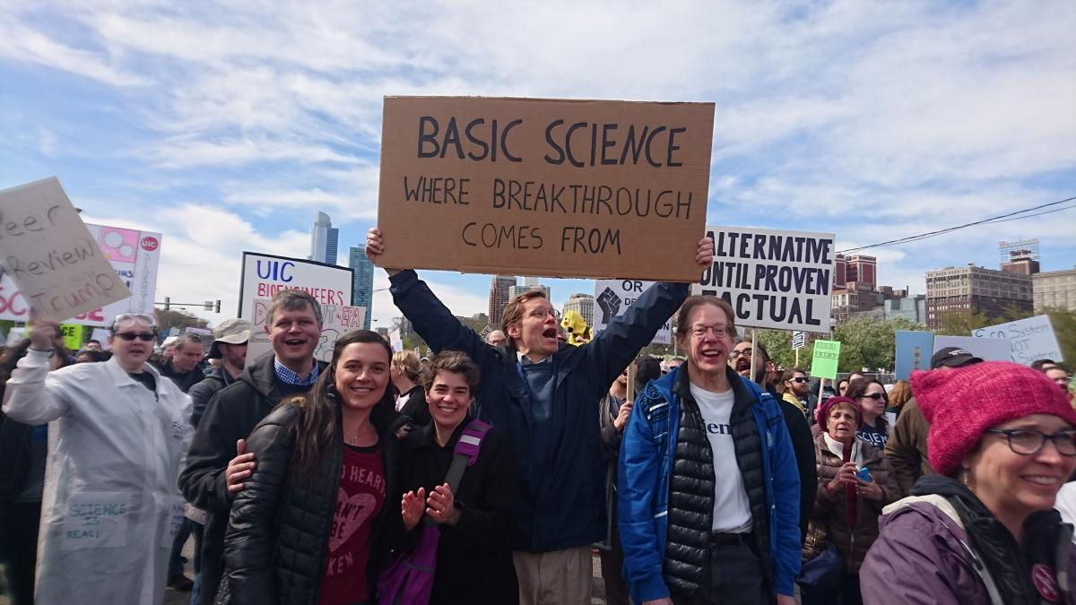 BSD Faculty post with signs at the March for Science Chicago