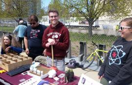 Members of the Lynch lab pose next to their expo table