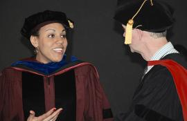 Kristen Voorhies (PhD'16) chats with Professor Michael Coates at convocation.