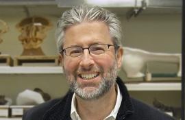A close-up shot of Neil Shubin in his lab.